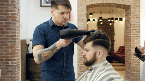 VideoHive Barber Getting Groomed at Hairdresser with Hair Dryer While Sitting in Chair at Barbershop 19618240