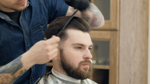 VideoHive Portrait of Attractive Young Man Getting Trendy Haircut Male Hairdresser Serving Client 19618372