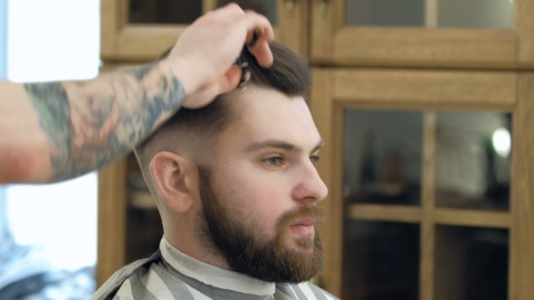 VideoHive Portrait of Attractive Young Man Getting Trendy Haircut Male Hairdresser Serving Client 19618382