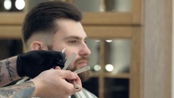 VideoHive Portrait of Attractive Young Man Getting Trendy Haircut Male Hairdresser Serving Client 19618418