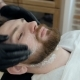Hairdresser Covering Face of Client with Towel. Man Visiting Barber Shop. - VideoHive Item for Sale