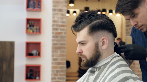 VideoHive Men's Hairdressers Barbers Barber Cuts the Client Machine for Haircuts Background Salon Barbershop 19620139