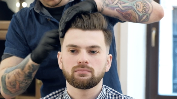 VideoHive Male Barber in Plaid Shirt Combing Hair of a Male Client at Barbershop 19620420
