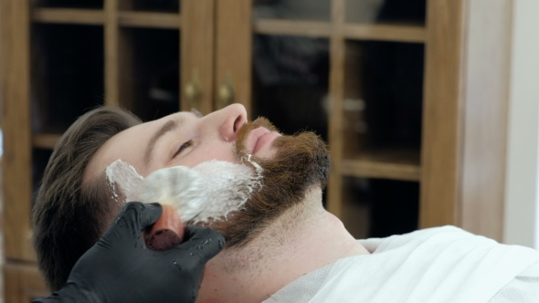 VideoHive Client During Beard Shaving in Barber Shop 19620434