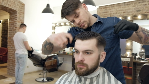 VideoHive Barber Style Male Barber in Plaid Shirt Combing Hair of a Male Client at Barbershop 19620466