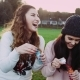 Hipster Girls Smiling and Laughing While Blowing Bubbles .Happiness in Their Eyes