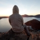 2.5D Parallax Video Hooded Man Sitting on Edge of Rock Cliff Watching Sunrise Above Crater Lake - VideoHive Item for Sale