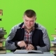 Guy Suddenly Finds His Article in the Book and Is Very Happy. Green Screen