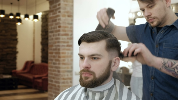VideoHive Spraying Hair Portrait of a Barber Spraying Water on the Hair 19632273