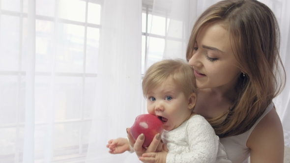 VideoHive Mother Holding Baby with Apple 19637545