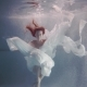 Young Woman with Long Red Hair Swimming Underwater Like a Fairy Tale - VideoHive Item for Sale