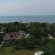 Aerial Shot of the Tropical Bay with Stony Beach, Boats and Buildings. - VideoHive Item for Sale