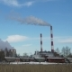 Thermal Power Plant or a Factory with Smoking Chimneys and a Solitary Tree - VideoHive Item for Sale