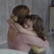 Daughter Rushes Into Mother's Arms at Home and Gives Her a Big Hug