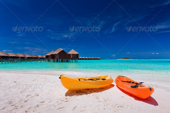Colourful kayaks on the tropical beach - Stock Photo - Images