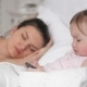 Portrait of Little Girl and Tired Mother in the Bedroom. Woman Is Sleeping - VideoHive Item for Sale