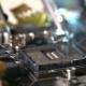 Technician Plug in CPU Microprocessor To Motherboard Socket