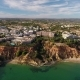 Aerial. Tourist Town Olhos De Agua on the Sandy Mountains - VideoHive Item for Sale
