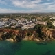 Aerial. Tourist Town From the Sky Olhos De Agua on the Beach Shores - VideoHive Item for Sale