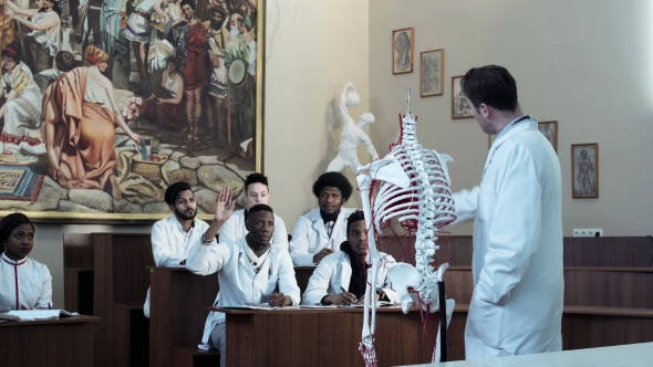 Group Of Medical Students At An Anatomy Lecture By Framestock