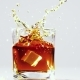 Two Ice Cubes Falling Into Glass with Brandy. - VideoHive Item for Sale