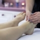 Woman Enjoying a Feet Massage in a Spa