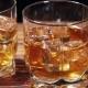 Glasses of Malt Whiskey on a Black Table