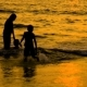 Mother and Two Kids Are Playing at Sunset Beach - VideoHive Item for Sale