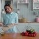 Beautiful Young Woman Preparing Vegetables