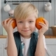 Cute Smiling Young Boy with Orange on Kitchen, Portrait of Child, Happy Family