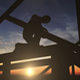 Silhouette Of Construction Worker On Roof Top - VideoHive Item for Sale
