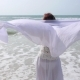 Lifestyle: Middle-Aged Female in White Clothes on Beach - VideoHive Item for Sale