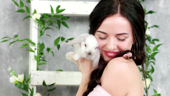 Portrait of Happy Smiling Woman Holding White Cute Long-eared Rabbit, Spring Photo Session