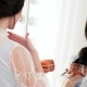 Beautiful Woman Holding Orange Jar of Pure Cream and Applying Product To Get Amazing Natural Look Nulled