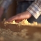 The Carpenter Sweeps the Shavings off the Wood with Wood - VideoHive Item for Sale