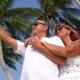 Senior Couple Having Fun at Beach Against Palm Trees.