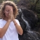 Beautiful Girl Thanks Namaste at Waterfall While Meditating - VideoHive Item for Sale