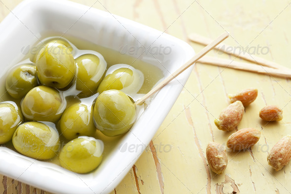 the green olives in ceramic bowl - Stock Photo - Images