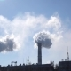 White Clouds in the Sky From Pipes of Industrial Plant