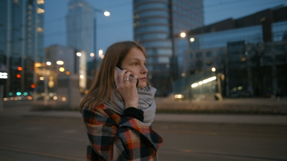 VideoHive Young Woman Is Talking on Phone and Walking in the Night Modern City Center 19716957