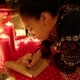 Teen Girl Is Lying and Writing a Letter To Santa Claus on New Years Eve