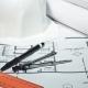 Engineer's Desk with Drawings, Helmet, Ruler, Pencil