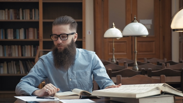 VideoHive Student Preparing Exam and Learning Lessons in School Library 19728503
