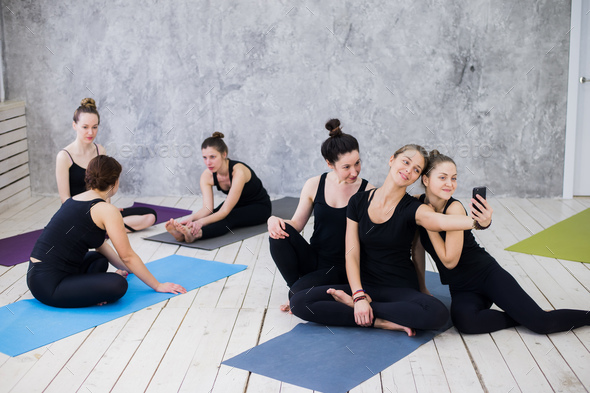 Three young women making selfie after workout at yoga class - Stock Photo - Images