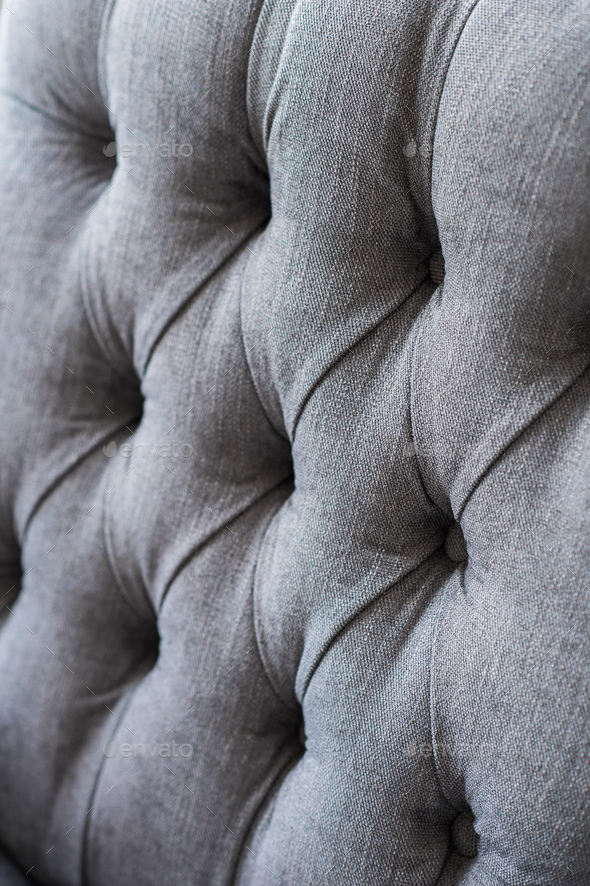 Seamless background texture close up of a grey sofa back with button detail on a thick cloth. - Stock Photo - Images