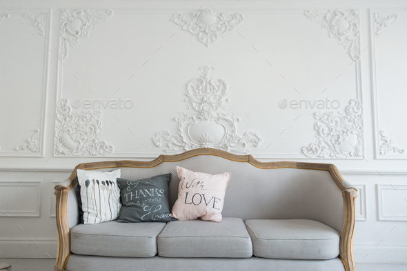 Beautiful Provance Living Room With Sofa over luxury wall decorated with stucco mouldings - Stock Photo - Images