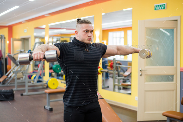 Young handsome athlete in old rusty gym - Stock Photo - Images