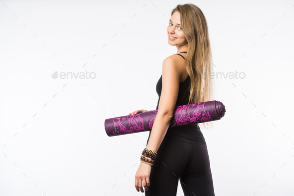 Back view portrait of a young fitness woman with yoga mat over white background - Stock Photo - Images
