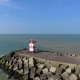 Aerial Shot of North Sea with Lighthouse and Pier. Drone Flying Above Sea in Hague - VideoHive Item for Sale