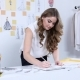 Fashion Designer Draws Sketches for a New Collection in Her Workshop